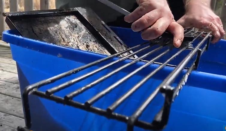 Scrubbing the grill grates