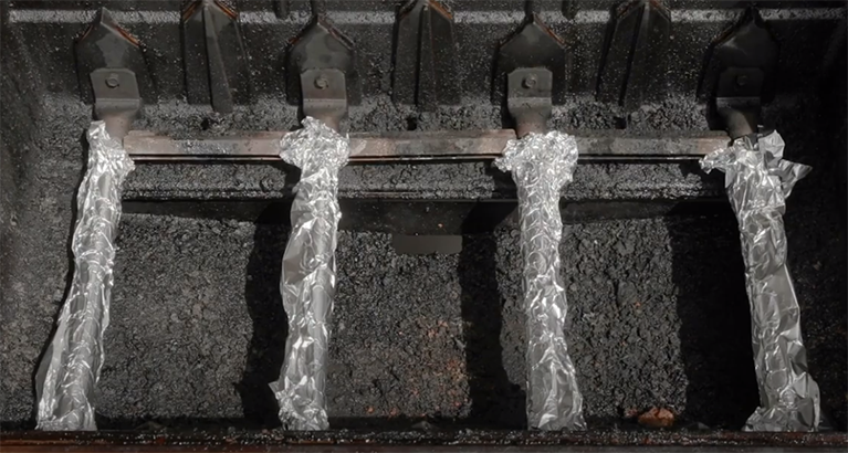 Wrapped heating elements in aluminum foil