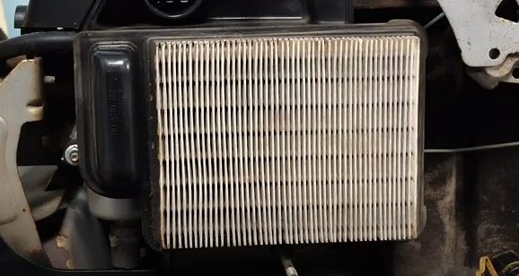Inspecting the air filter.