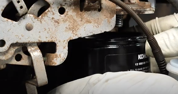 Removing and inspecting the engine oil filter.