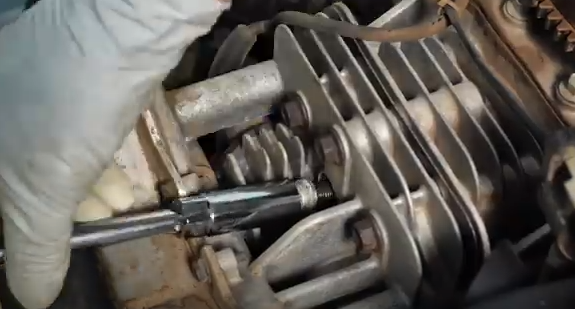 Removal of the spark plug.